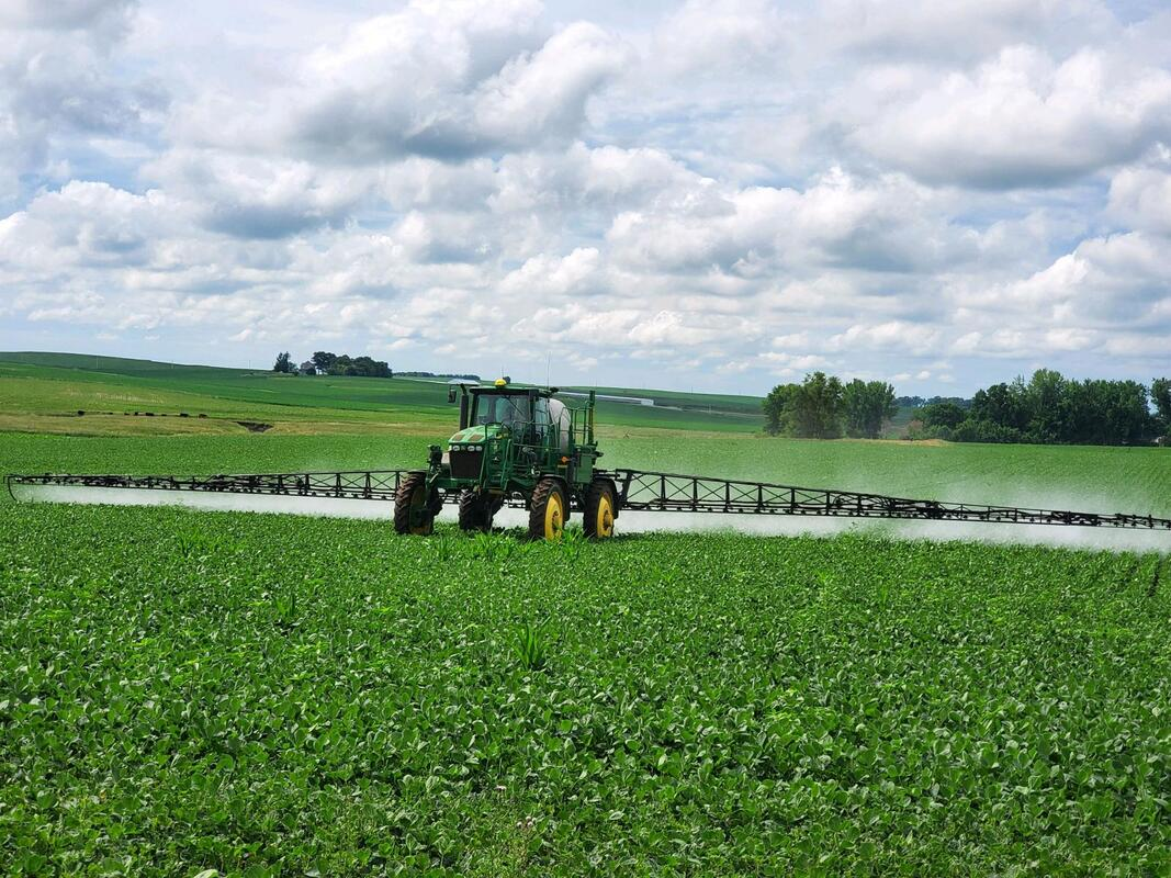 Our agricultural chemicals being applied to a field